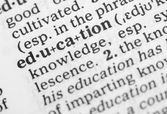 Macro image of dictionary definition of education — Stock Photo