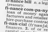 Macro image of dictionary definition of finance — Stock Photo