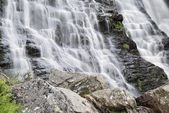 Landscape detail of waterfall over rocks in Summer long exposure — Stock Photo