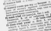 Macro image of dictionary definition of financial — Stock Photo