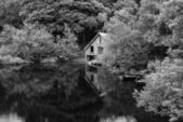Black and white retro style picture of derelict boathouse and ro — Stock Photo