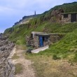 Old fishing huts in landscape Cape Cornwall — Stock Photo