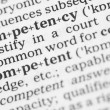 Macro image of dictionary definition of competency — Foto de Stock