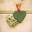 Stock Photo: Macro retro cross processed effect image of hearts on wooden bac