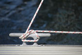 Detail image of yacht rope cleat on sailboat deck — Stock Photo