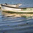 Old fishing boats reflected in calm water during Summer sunset — Stock Photo #30078601