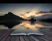 Creative concept pages of book Stunning mountain and lake sunris — Stock Photo