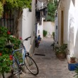 Typical old Mediterranealley between old houses with bike abn — Stock Photo #31895787