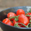 Stock Photo: Beautiful fresh Perino snacking tomatoes in bowl in rustic setti
