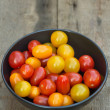Fresh juicy Heirloom tomatoes in rustic setting — Stock Photo