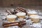 Warm image of Christmas foods on rustic style wooden background — Stok fotoğraf