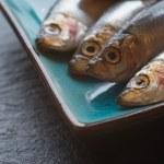 ������, ������: Fresh tasty raw sprats on serving dish