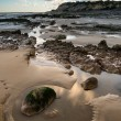 Stock Photo: Summer landscape with rocks on beach during late evening and low
