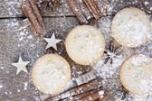 Warm image of Christmas foods on rustic style wooden background — Stock Photo