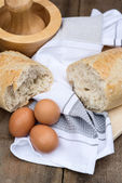 Loaf of sourdough bread in rustic kitchend setting — Stock Photo