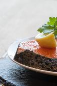 Raw fresh salmon cutlet steak with lemon and parsley garnish — Stock Photo