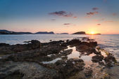 Stunning landscapedawn sunrise with rocky coastline and long exp — Stock Photo