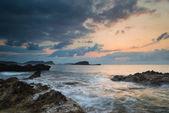 Sunrise over rocky coastline on Meditarranean Sea landscape in S — Stock Photo