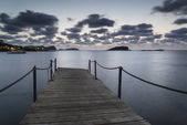 Stunning landscape dawn sunrise over jetty and long exposure Med — Stock Photo