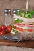 Fresh club sandwich in rustic kitchen setting — 图库照片