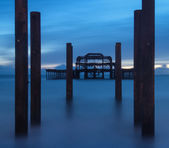 Blue hour landscape of destroyed old pier long exposure — Stock Photo