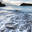 Long exposure of waves receding on beach ladnscape — Stock Photo #40587369