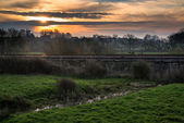 Dwn over railway tracks through countryside landscape — Stock Photo