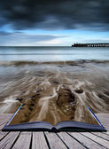 Book concept Long exposure seascape landscape during dramatic ev — Stock Photo
