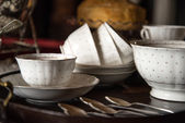 18th Century cups and saucers crockery on inlaid wooden serving  — Stock Photo