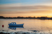 Landscape tranquil harbour at sunset with yachts in low tide — Stock Photo