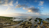 Panorama landscape looking out to sea with rocky coastline and b — Stok fotoğraf