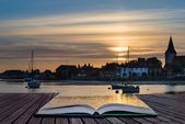 Landscape tranquil harbour at sunset with yachts in low tide Cre — Stock Photo