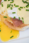 Eggs Benedict toasted English muffins ham poached eggs and holla — Stock Photo