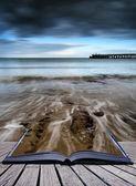 Book concept Long exposure seascape landscape during dramatic ev — Stock Photo