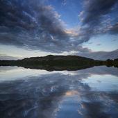 Beautiful moody sunrise over calm lake — Stock Photo