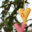 Handmade fabric christmas hearts — Stock Photo