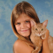 Lovely portrait of girl with kitten — Stock Photo