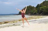 Jumping girl on island — Stock Photo