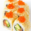 Japan sushi roll with salmon caviar isolated on white — Stock Photo