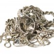 Isolated pile of gold jewelry on white background (chains, necklaces, bracelets, earrings, rings and other scrap gold).  — Stock Photo