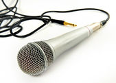 A microphone with a cord isolated on a white background. — Stock Photo