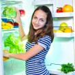 Beautiful Young girl near the Refrigerator   with healthy food — Stock Photo