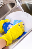 Close up hands of Woman Washing Dishes in the kitchen — Stock Photo