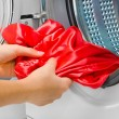Housework: young woman doing laundry — Stock Photo #36464157