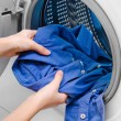 Housework: young woman doing laundry — Stock Photo #36464247