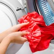 Housework: young woman doing laundry — Stock Photo #36464343