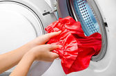 Housework: young woman doing laundry — ストック写真