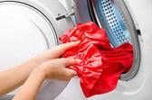 Housework: young woman doing laundry — Foto de Stock