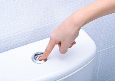 Finger pushing button and flushing toilet