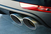 Close up of a car dual exhaust pipe — Foto Stock